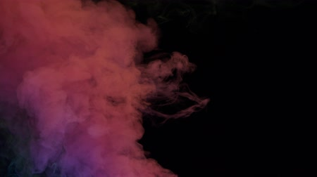 fontain : yellow and pink bomb smoke on black background Stock Footage