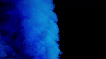blue bomb smoke on black background