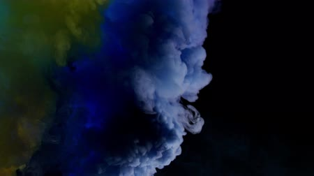 fontain : yellow and blue bomb smoke on black background