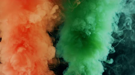 мистик : orange and smaragd emerald bomb smoke on black background