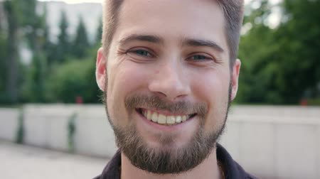gentleman : A happy smiling man with a beard in the city street. Close-up shot. Soft focus Stock Footage