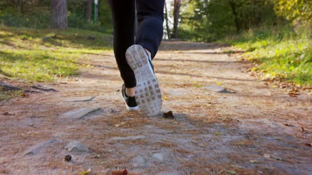 perspiration : A young mans feet running in the forest. Close-up shot