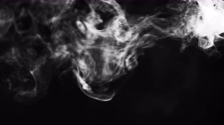 éteri : White clouds of vapor smoke are isolated on a black background. Gas explodes, swirl and dances in space. A magic fog dust texture effect that can be used by overlay and changing their transparency.