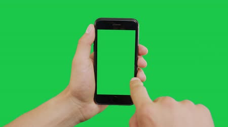 kettyenés : Bottom Right Click Smartphone Green Screen. Pointing Finger Clicking On Phone Screen with Green Background. Use in any project that depicts finger, gesture, touchscreen and the like. Stock mozgókép
