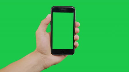 hírnök : Zooming In Smartphone Green Screen. Pointing Finger Clicking On Phone Screen with Green Background. Use in any project that depicts finger, gesture, touchscreen and the like. Stock mozgókép
