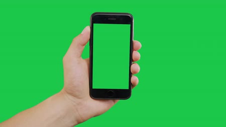 kettyenés : Zooming Out Smartphone Green Screen. Pointing Finger Clicking On Phone Screen with Green Background. Use in any project that depicts finger, gesture, touchscreen and the like.