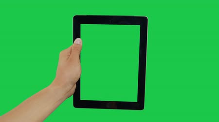 hírnök : Pointing Finger Clicking Top Center On Device Screen with Green Background. Digital Tablet Green Screen. Use in any project that depicts finger, gesture, touchscreen and the like.