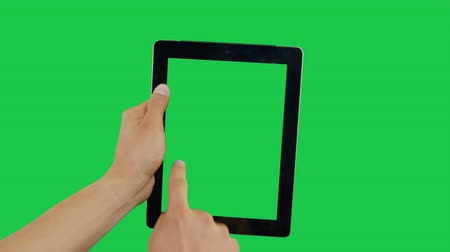 correio : Pointing Finger Clicking On Left Device Screen with Green Background. Digital Tablet Green Screen. Use in any project that depicts finger, gesture, touchscreen and the like.
