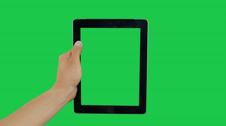 hírnök : Pointing Finger Clicking On Center Device Screen with Green Background. Digital Tablet Green Screen. Use in any project that depicts finger, gesture, touchscreen and the like.