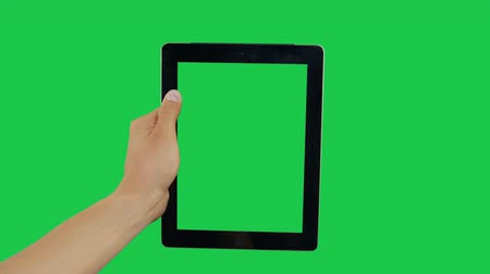 hírnök : Pointing Finger Clicking On Right Device Screen with Green Background. Digital Tablet Green Screen. Use in any project that depicts finger, gesture, touchscreen and the like.