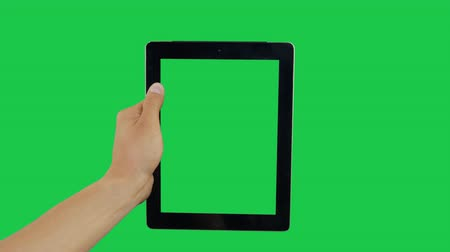 mensageiro : Pointing Finger Clicking On Bottom Right Device Screen with Green Background. Digital Tablet Green Screen. Use in any project that depicts finger, gesture, touchscreen and the like.