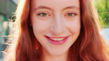 szempillák : Red-haired lady. Emotion. Smile Closeup shot