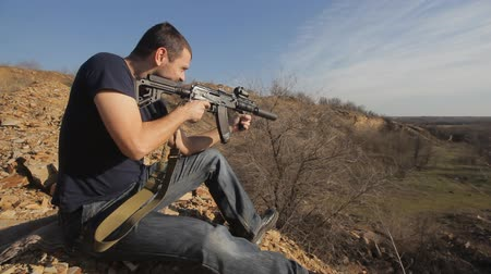 shooting range : man firing customised russian machine gun, wide