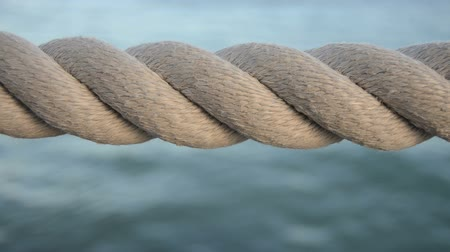 donanma : Nautical Video Of Some Weathered Harbor Rope Against A Blue Ocean Background