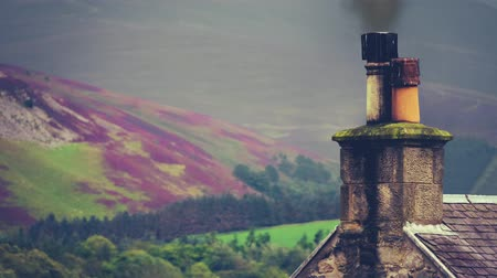 weathered : Rural House In The Scottish Borders Against The Purple Heather With Chimney Smoke