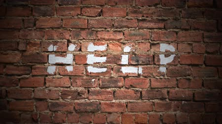instabil : The Word Help Written As Graffiti On A Vintage Red Brick Wall