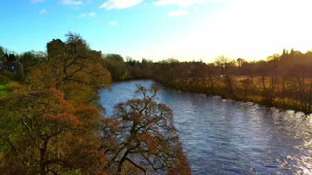 пьедестал : Aerial Panning Shot From Drone Of A Rural Scene In Scotland With River And Castle