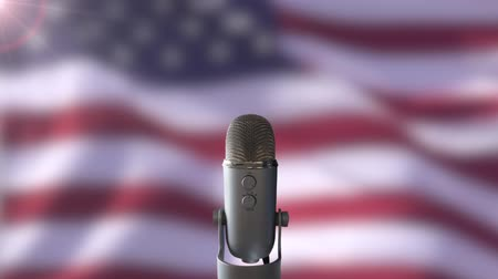 siyasi : A Microphone In Front Of A Slow Motion USA Flag Ready For A Public Address From The President