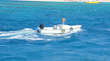 People on Boat Are Sailing in Sea