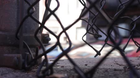 soft : Low angle shot through chain link fence, no movement Stock Footage
