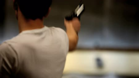 sportsmen : man shoots a gun  Stock Footage