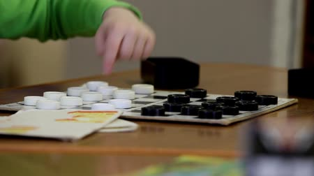 game of checkers of two preschoolers Stock Footage