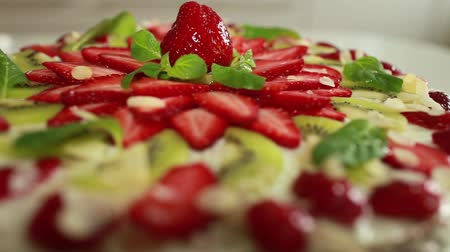 pastry : strawberry cake sequence. dolly shot. close to. Stock Footage