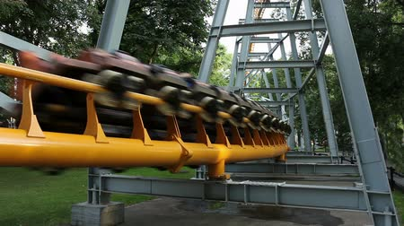 aventura : roller coaster speeds by. sequence.