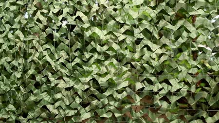 сокрытие : military camouflage net background camera motion