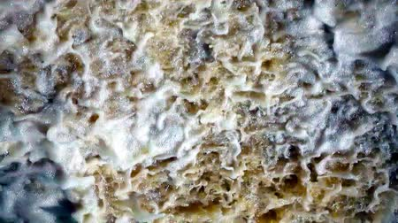 âmbar : foaming stream of a seething water abstract background