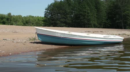 rowboat : Empty rowing on the sandy shore view from the water to the shore Stock Footage