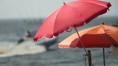 motorbot : umbrella and motorboat on beach shallow depth of field zoom in