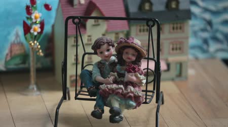 marionetka : puppet theater loving couple on a swing