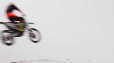 Motorcycles in flight over  head, high jump, motocross winter