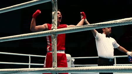 victor : St. Petersburg, Russia, November 23, 2016 Youth World Boxing Championship men, Boxing referee holds up winning boxers arm ring after boxing match Stock Footage