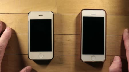 comparar : Two smartphones waiting cal overhead shot