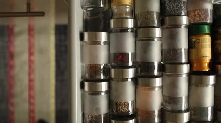 koriander : Spices in glass jars cutlery drawer opens overhead view