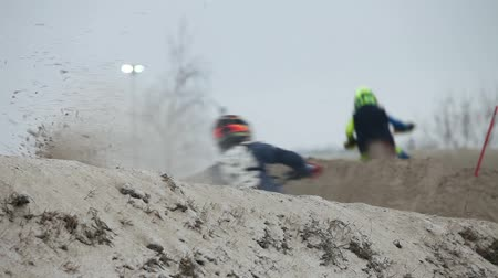 Motocross race on motorcycles snow slides with sound