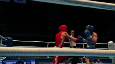 agressivo : St. Petersburg, Russia, November 23, 2016 Youth World Boxing Championship men 60 kg  RED - Mamataly N, Kazakhstan, BLUE- Khamzaev  B. Russia.