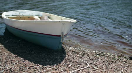 rowboat : Rowing boat at shore Swaying wave, summer sunny day