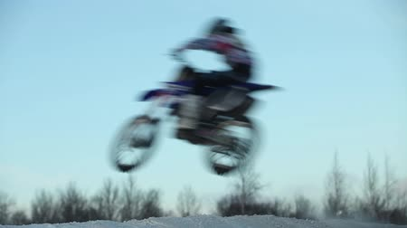 consistency : flight jumps  on motorcycle side view low angle sound Stock Footage