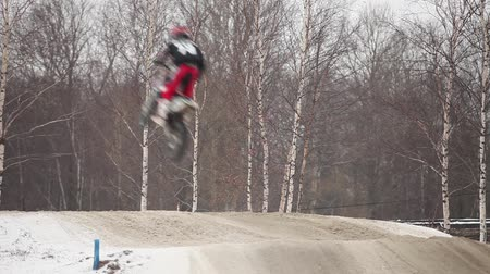 jumps flight on motorcycle motocross back view . Stock Footage
