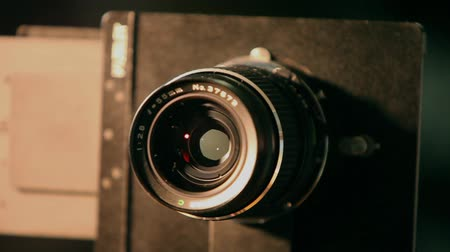 camera rotation : Retro camera medium format turns close up. Stock Footage