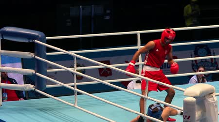 ás : St. Petersburg, Russia, November 22, 2016 Youth World Boxing Championship  men heavy 69 kg. Boxing match between: RED-. Akbar M. England, BLUE - Newns S. Scotland Stock Footage