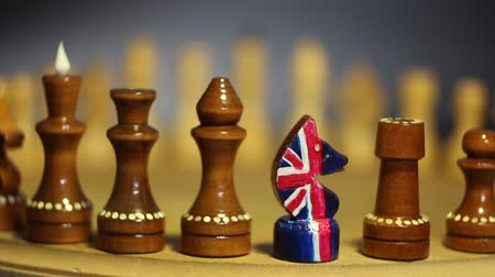 disintegration : Chess figures in a row British chess knight leader