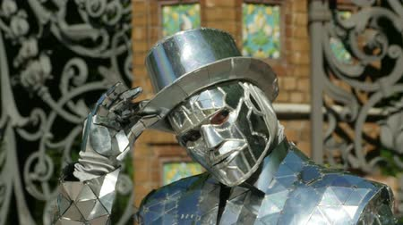 Man in the Iron Mask, takes off his hat Living statue performer Stock mozgókép