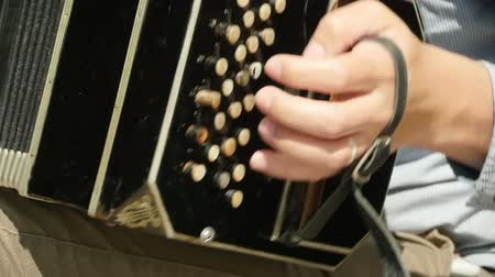 musical intrument : left bass keyboard bandoneon, close to slow motion