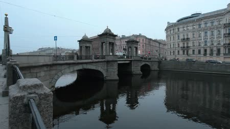 Old stone bridge with towers, in St. Petersburg winter