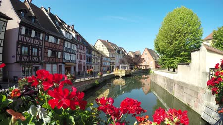post and beam construction : Colmar, Alsace, France - Canal boats at Little Venice. Medieval old town, half-timbered houses. Stock Footage