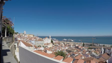 truly : Lisboa, Portugal. viewpoint Largo das Portas do Sol, a balcony opens onto the river offering truly spectacular views over Alfama. Stock Footage